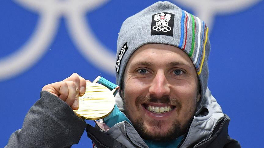 Austria's gold medallist Marcel Hirscher poses on the podium during the medal ceremony for the Men's alpine skiing combined at the Pyeongchang Medals Plaza during the Pyeongchang 2018 Winter Olympic Games in Pyeongchang on February 13, 2018.